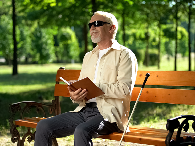 LBPH Resource; Image of blind man reading a book in braille.